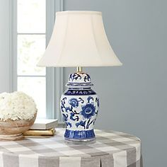 Our Blue and White Round Table Lamp is crafted of ceramic with flowing floral motif. A clear acrylic base adds a light, modern note. Jar Lamp, Ginger Jars, Blue And White Vase, Lamp, White Vases, White Round Tables, Jar Table Lamp, Blue Table Lamp, Ginger Jar Lamp