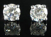 Diamond studs- if anything I try to leave the house w/ some kind of earrings! preferably studs
