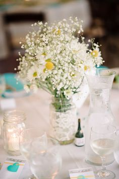 DIY centerpiece: ivory lace wrapped mason jar with DIY daisy and billy ball floral arrangement