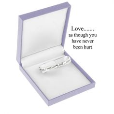 "Equilibrium Silver Plated Bangle - Love as though.A beautiful silver plated bangle with a special message inscribed on it  ""LOVE..... as though you have never been hurt""  Equilibrium jewellery makes a very special personal gift with a sentimental message ... a gift with meaning  The bangle comes in a beautiful gift box, ready to present to the lucky recipient  Size: 1cm x 7.5cm"