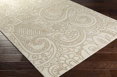 Queensland Area Rug has unique pattern in khaki beige coloration to add an artistic touch to your home decor. Made of viscose and wool with cotton canvas backing.