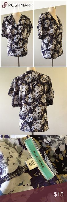 """Pleione Floral Wrap Style Blouse Pleione Floral Wrap Style Blouse. Size XL. Gorgeous blouse. Has snap buttons and Blouse fits like a wrap. Style #WBL52779. Thank you for looking at my listing. Please feel free to comment with any questions (no trades/modeling).  •Fabric: 100% polyester  •Bust: 44"""" •Length: 22"""" •Condition: VGUC, no visible signs of wear.   ✨Bundle and save!✨10% off 2 items, 20% off 3 items & 30% off 5+ items! AB Pleione Tops Blouses"""