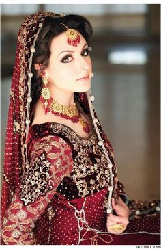 gorgeous bride. love the outfit, jewels, makeup!