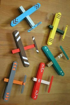 Popsicle stick and clothes pin Airplane. Let the kids paint their own and then use string to hang them from the ceiling
