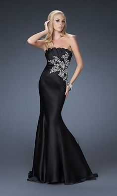 long black dress. Pleated top and embroidered snowflake or flower.