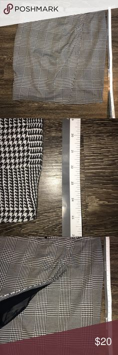 Houndstooth design skirt Houndstooth design skirt with wrap style front. Skirt is lined on the inside and has an invisible zipper in the back at the top. The length is in a picture in the description. Lane Bryant Skirts Mini