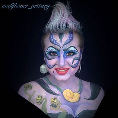 Ursula, The Little Mermaid. Make up is really intense but you could do the faux hawk with grey and purple hair spray.