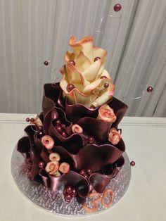 Chocolate Wrap Cake. A dark moist chocolate cake with dark Lindt chocolate ganache & a moist vanilla bean sponge cake with white Lindt chocolate ganache all wrapped up in Lindt modeling chocolate.