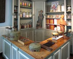 Old Candy Shop-love love love the butcher's  block counters......the green tins are beyond cool