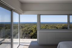 Upstairs, panoramic views of the ocean and landscape intensify the perception of…