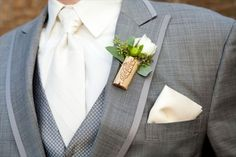 cork boutonniere - wine themed wedding ideas
