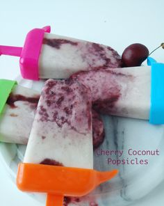 Cherry Coconut Popsicles ...makes 4...1 c fresh cherries, pitted, 1 TAB sugar , 1 6 oz 2% Chobani Coconut Greek yogurt, 3 Tab sweetened coconut flakes, toasted