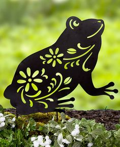 Display an Animal Silhouette Stake in your garden or in a planter on the porch. It's made of black, die-cut metal with floral cutouts. Has 2 stakes to secu