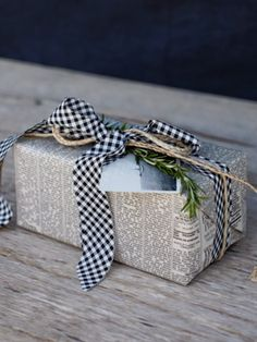 newspaper  check ribbon w/ a little sprig of rosemary.