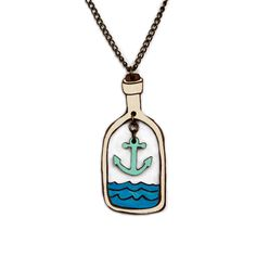 Anchor Inside the Bottle Necklace: Bring back summer with the new 'Seaside' collection from Manolo. This charming 'Anchor inside the bottle' necklace is based on an original hand drawn illustration by Marta Chojnacka. -Painted, varnished and assembled by hand at her Barcelona's workshop -Made using natural solid walnut wood -Varnish coat has been applied by hand to each item for a lasting finish -The chain is anti-allergic and nickel free