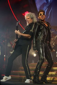 Snapshot: August 22 - Brian May And Adam Lambert           - They will rock you. Queen's Brian May and Adam Lambert tear up the stage during a performance on Aug. 22 in Perth, Australia