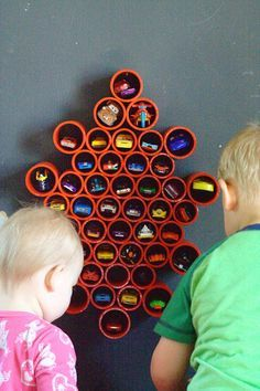 Organize all of your cars with this DIY Car Storage for the wall.  It's super easy to make!