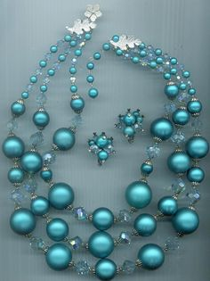 Gorgeous vintage Vendome 3-strand necklace and earrings -- awesome teal lucite beads and ultra-rare vintage Swarovski crystals