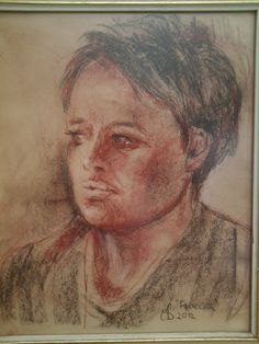 'Francesca' by Christine Becattini. 30cms x 37cms Portrait of my daughter using Conte pastels, black,  brown and sanguine on buff pastel paper.