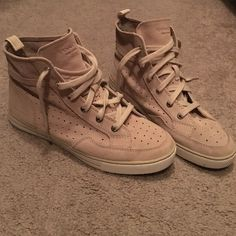 Coach suede high tops So freaking cute! They are a size 10 but could fit a size 10.5 probably. Just a little to big for me or I would be wearing them EVERYDAY! Never worn out. Just worn around the house a little bit. Coach Shoes Sneakers