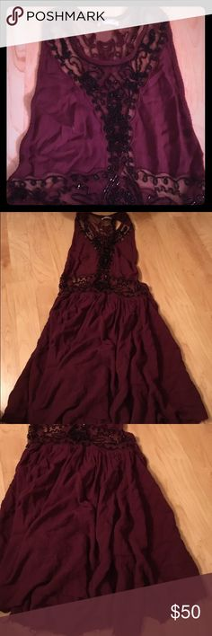 Free people beaded baby doll tank Beaded free people tank baby doll style. Burgundy, black sheer beading and a racer back accent. A beauty! Fits xs/s Free People Tops Tank Tops