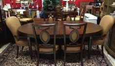 "Lexington Furniture Art Deco Dining Set. Oval table has veneer set in a sunburst on top and rose copper colored hardware. Table measures 82"" x 44"" plus 2 24"" leaves. Matching china cabinet, mirror and sideboard also available. SOLD"