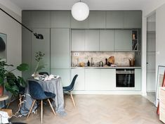 Mint green kitchen and natural stone - via Coco Lapine Design blog