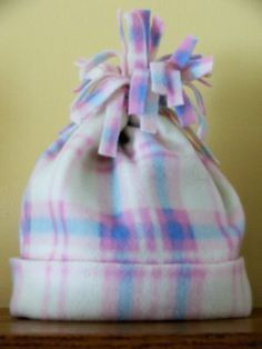 Easy one seam fleece hat to drop at shelters.  One yard of fabric should make 4 kids' sized hats.