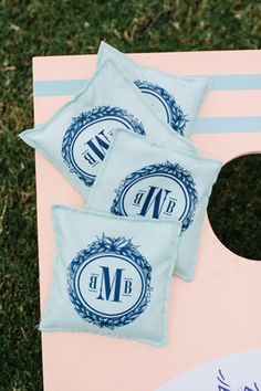 Monogrammed beanbags for wedding cornhole.