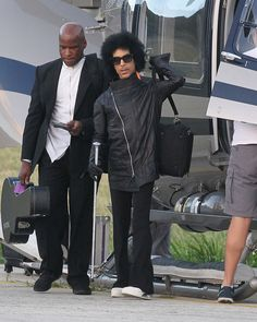 30 Dec 2015 - St Barts - France Legenday singer Prince seen arriving in St Barts via helicopter and walking with a cane!