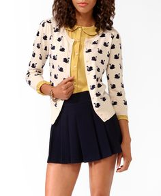 Pale Yellow Button-Up Peter Pan Collared Blouse and Navy Blue Pleated Skirt with Ivory and Black Swan-Print Cardigan