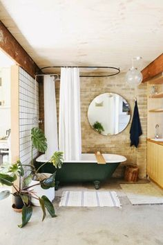 Beautiful bathroom spaces and inspiration on the blog - love this roll top bath and greenery from the plants