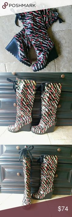 "✌VINTAGE & NEW Betsey Johnson Rain Boots Brand new, NEVER WORN, VINTAGE, Betsey Johnson Rain boots I am prying these from my hands to list these on Posh. The price is firm! So firm, that these can't be bundled!  Zebra print with pink roses 14"" Shaft comes up to knee  4"" Rubber wedge heel Black lace tie at top Will fit a wide calf due to lace adjustment at top!! Soft lining inside  Size is 8.5 but I'm a 7.5 & they fit fine. So use your own jugement. I never walked around in them…"