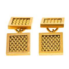 18k gold mesh cufflinks from Cartier.