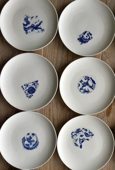 Jingdezhen porcelain plates with cobalt blue underglaze. Artist Maggie Moy has been inspired by shards found  in Jingdezhen< China