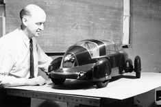 Gordon Buehrig with a model of the the 1948 Tasco.