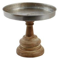 I'm in love with this gorgeous galvanized and wood cake stand. Click for decorating and serving ideas using cake stands, plus information on where to purchase this cake stand and dozens of others like it.