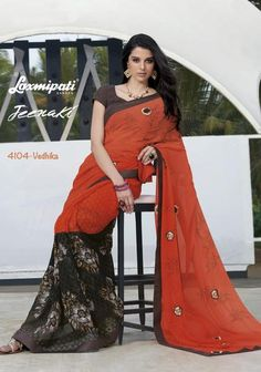Drape yourself sensuously with this gorgeous maroon and violet saree. Purchase this designer party wear saree online in India at best prices.