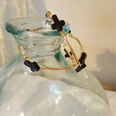 Bangles with small black crosses Beautiful gold wire bangles with small black stone crosses. Listing is for both bangles. Jewelry Bracelets