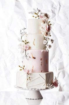 Floral Wedding Cakes Four Unique Takes On The Traditional White Wedding Cake Creative Wedding Cakes, Beautiful Wedding Cakes, Wedding Cake Designs, Beautiful Cakes, Modern Wedding Cakes, Traditional Wedding Cakes, Blush Wedding Cakes, Wedding Cake Toppers, Cake Wedding