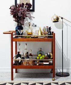 5 Genius Ways to Style a Bar Cart for Every Occasion | It's a serving station when you're entertaining, a display spot when you're not. Here are five top-shelf setups.