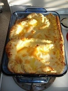 HOOTENANNY (Or Oven Pancake): Blend up 1 c. white flour, 1 c. milk, 6 eggs, and 1/4 tsp. salt. Pour batter into greased 9x13 pan. Then, pour 1/2 cup melted butter over the top (do not mix). Bake for 25 minutes at 400 degrees. Cut in pieces, drizzle with Maple Syrup, serve.
