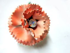 Orange Go Round by Laurie on Etsy. My Glass Ball with Flower was featured here.