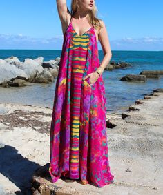 Red & Yellow Watercolor Maxi Dress   Dreamy, vibrant colors enliven this shoulder-baring maxi dress, boasting a lighter-than-air silhouette. An unexpected pocket adds convenience and an anchoring point.