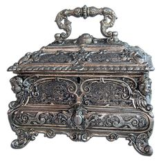 Beautiful antique 19th C. silver-plated decorative jewelry box lined with black velvet.