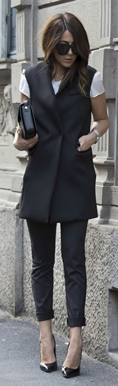 Why not try a black vest jacket over cropped black trousers for a sophisticated look. Via Nicoletta Reggio. Shops: not specified.