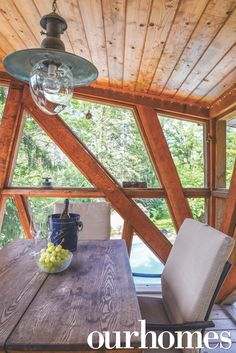 A treehouse gazebo that is one of a kind. This unique dining space has geometric wood details, and its rooftop perch allows for great views! What a cool idea.