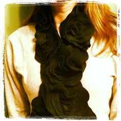 I made this scarf in about 4 hours. It cost only 2 bucks too! Here is the link to the tutorial...  http://watchmedaddy.blogspot.com/2011/12/felt-flower-scarf-tutorial.html