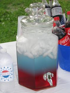 Layered 4th of July Punch - ice, cranberry juice, blue gatorade frost, diet 7up. Be sure to pour each layer onto the ice and not directly into the other juices so it doesn't mix. The varying amounts of sugar allow for the layering effect from different densities.