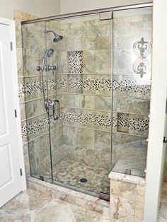 The homeowner wanted a luxurious retreat where she could relax and unwind. Mixed marble and mosaic tile in this walk-in shower give allow for a steamy, spa-like experience.